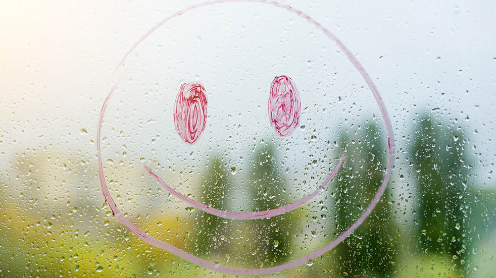 25 free things; smiley face on window