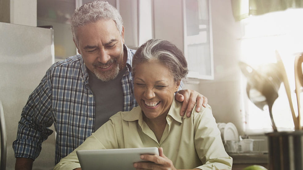 25 free things to do at home; couple chatting on tablet