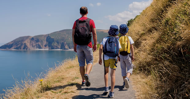 Family walking on a coastal path