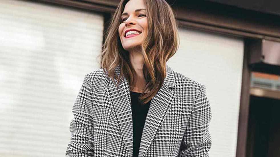 10 easy ways to boost your mood this autumn woman smiling in coat