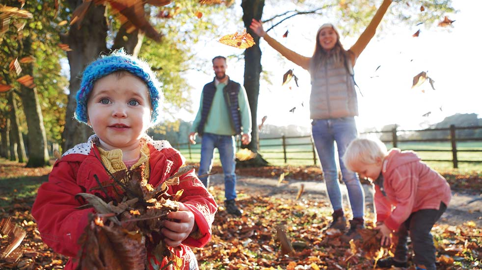 10 easy ways to boost your mood this autumn family playing with leaves