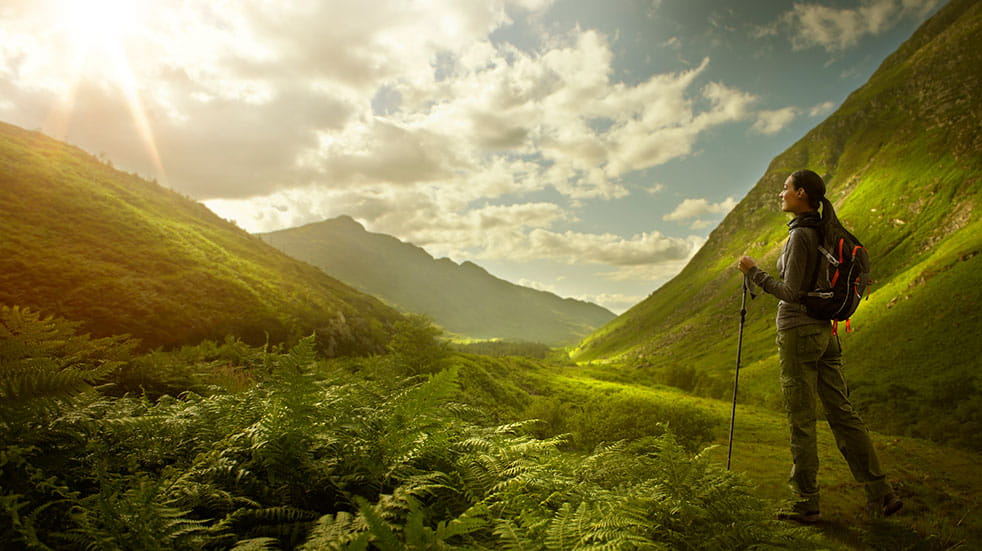 10 great british holiday destinations woman hiking mountains