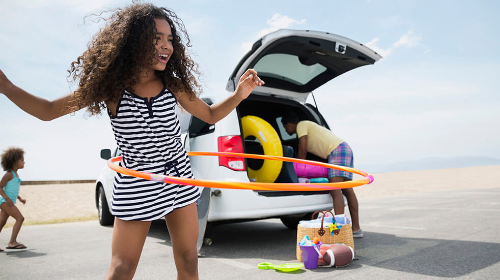 10 reasons to take a family road trip across America girl hula hooping