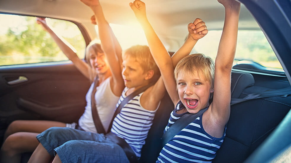 10 reasons to take a family road trip across America children in car