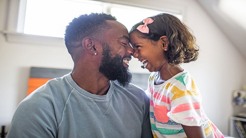 10 reasons why a Simply Cash Plan is for you; man and daughter smiling