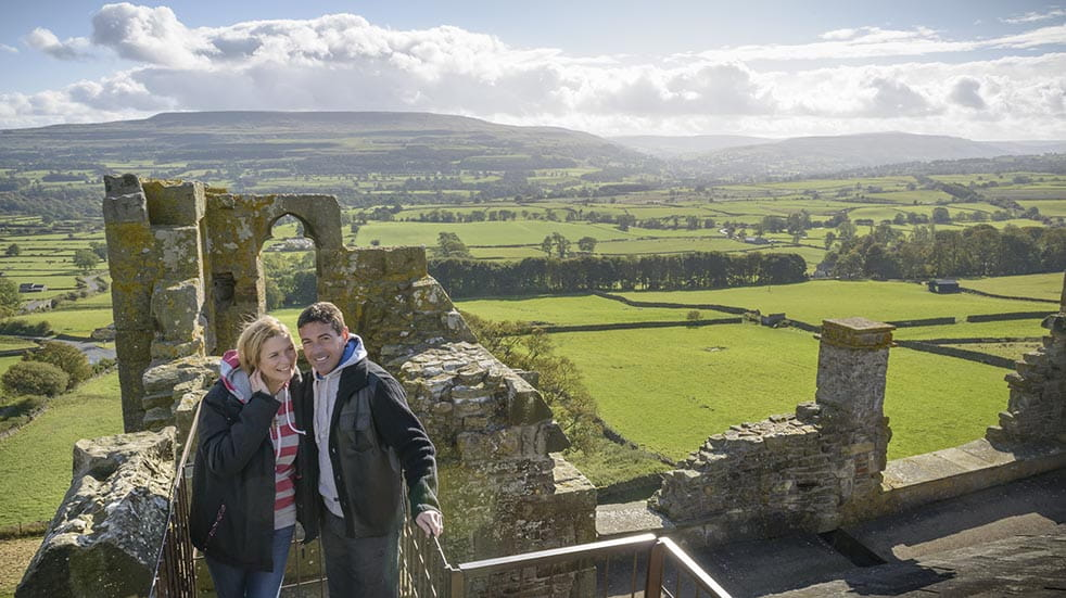10 socially distanced days out couple standing on castle walls