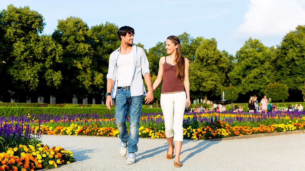 10 socially distanced days out couple walking in garden