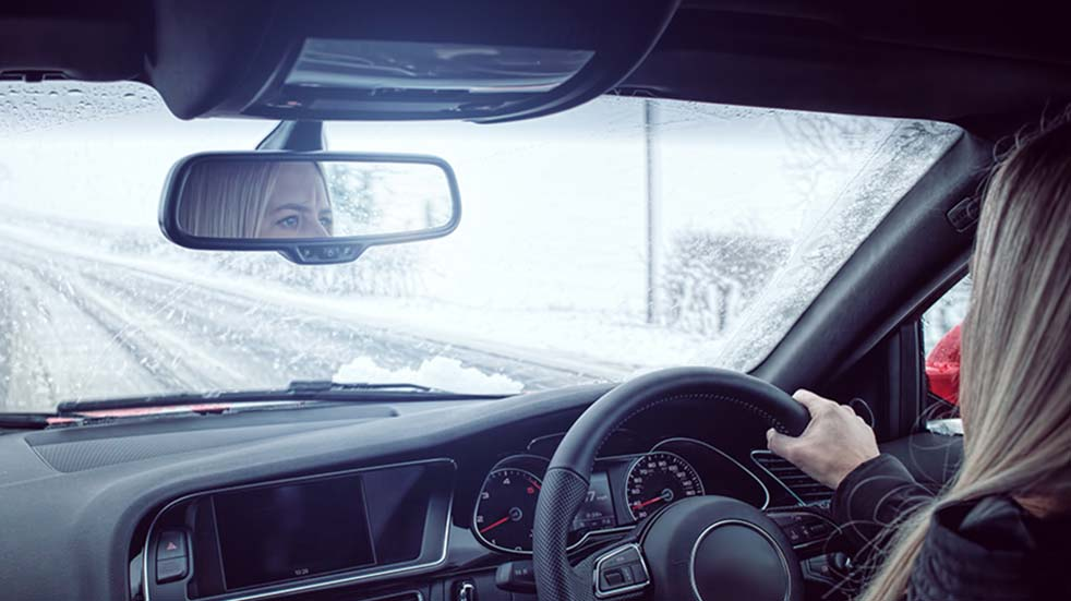 Winter driving tips woman car snowy
