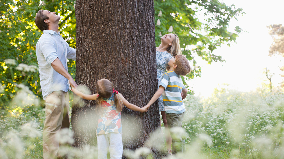 30 Days Wild: family hugging a tree