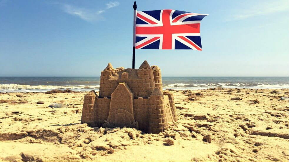 Sand castle at the beach with Union Jack