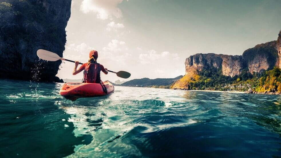 Woman kayaking on the ocean