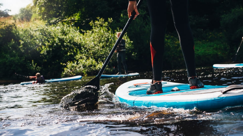 watersports to try stand up paddle boarding