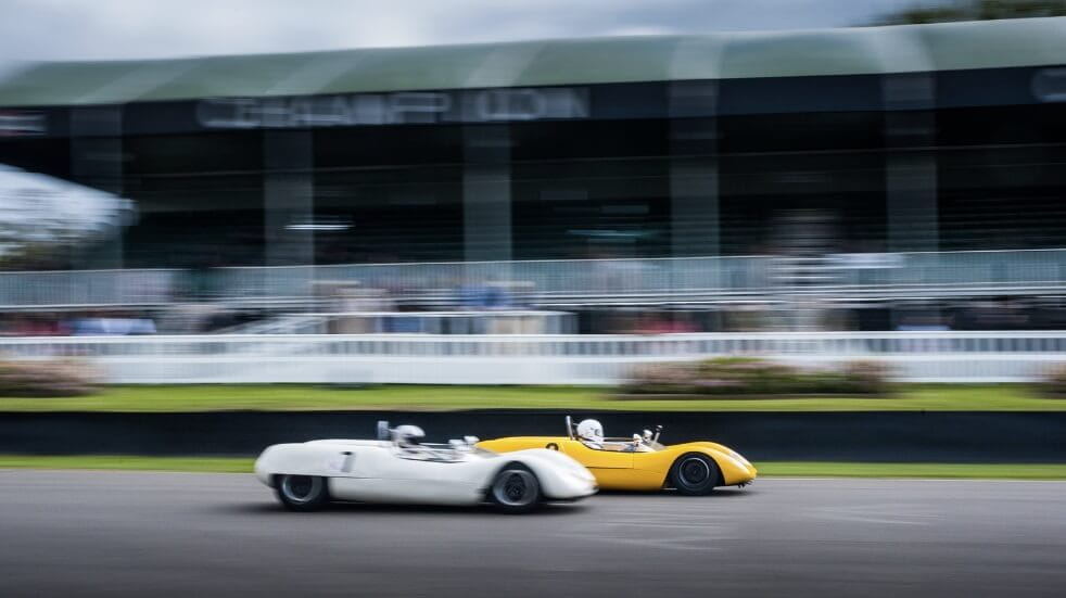 Two cars racing at Goodwood Revival