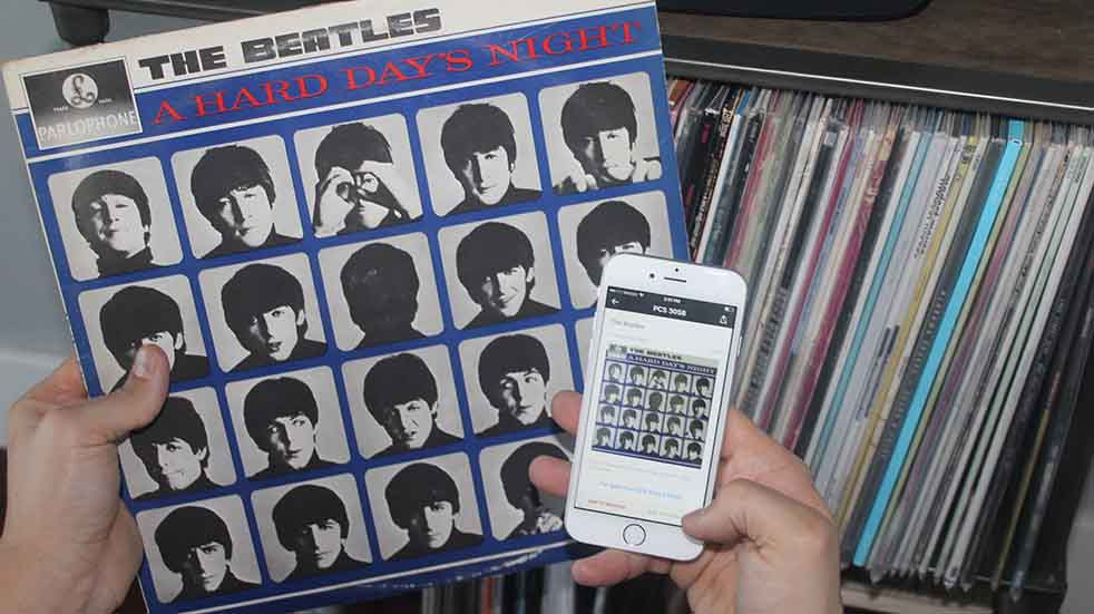 Looking at a Discogs App on a smart phone, with Beatles album in other hand