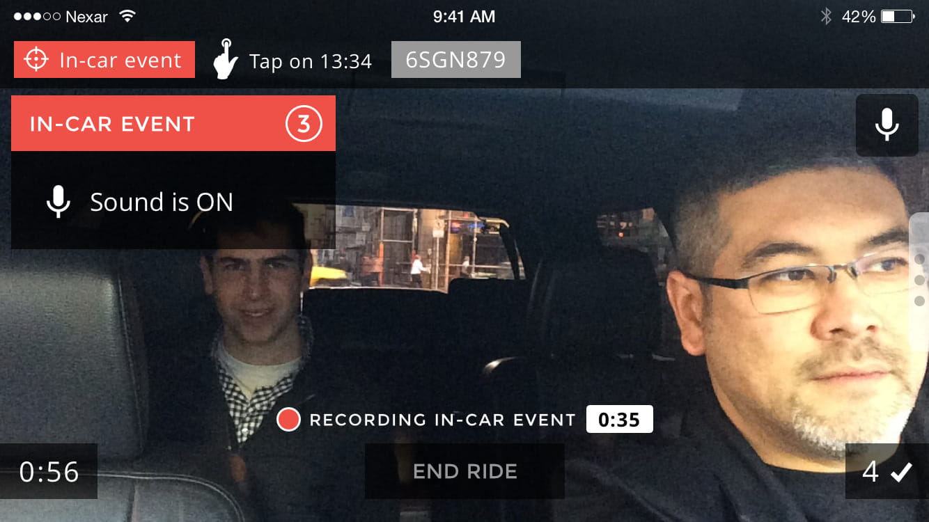 View of the inside of a car from the dashboard cam, working on the Nexar AI phone App