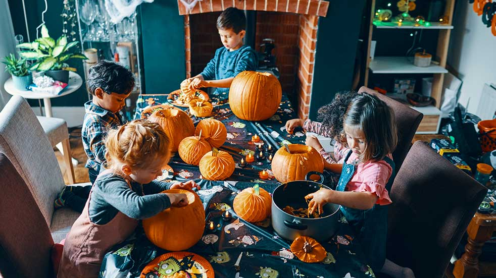 Kids carving pumpkins