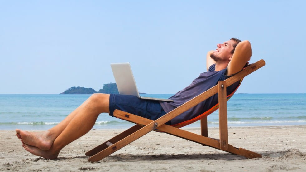 Armchair travel destinations man relaxing on beach