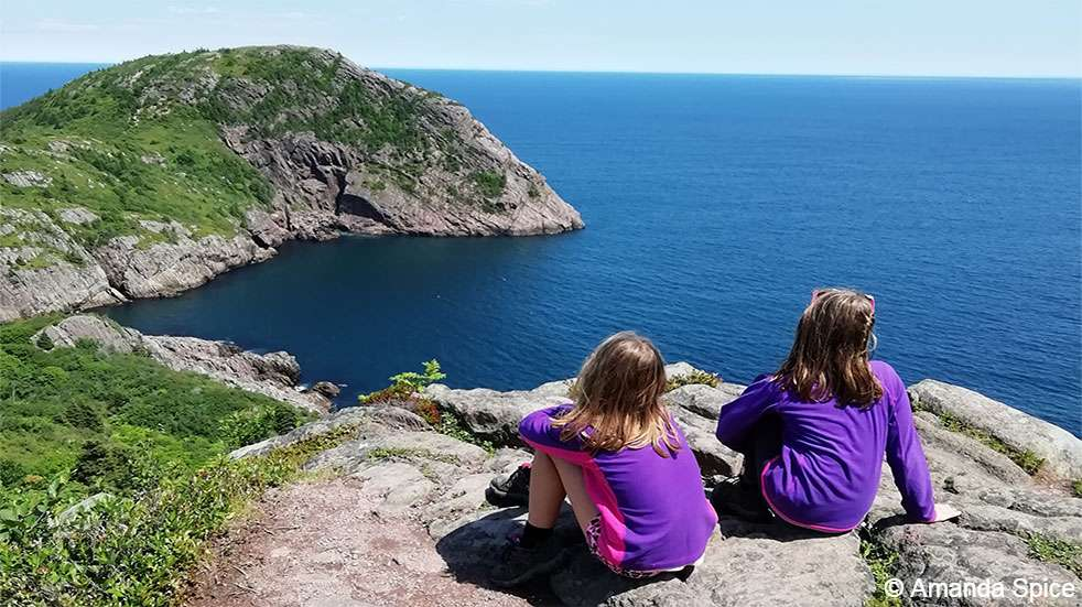 Backpacking with kids: children enjoying coastal view