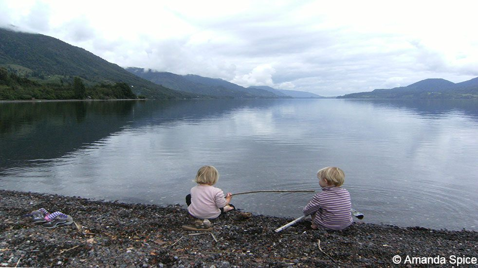 Backpacking with kids: children fishing in lake