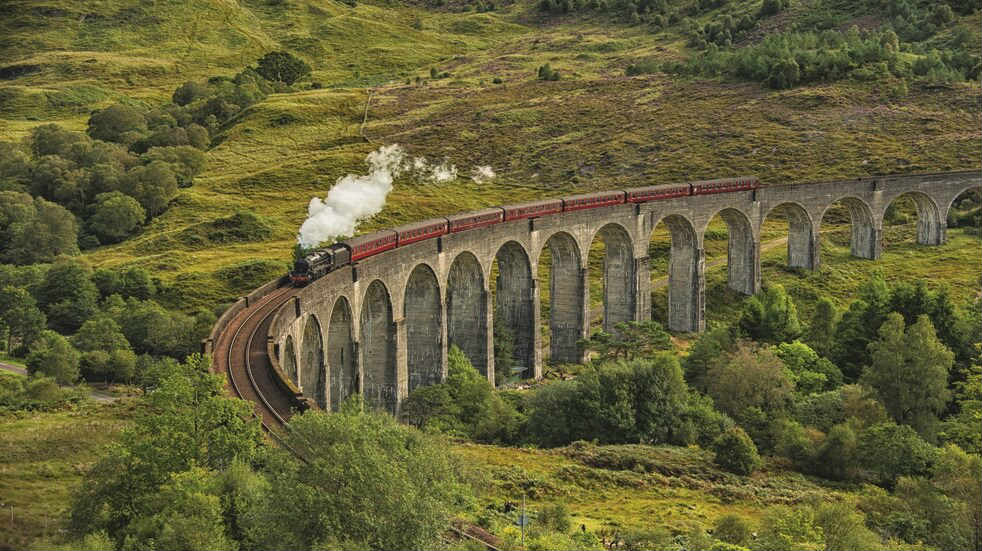 Glenfinnan Viaduct's graceful curve graces the West Highland Line