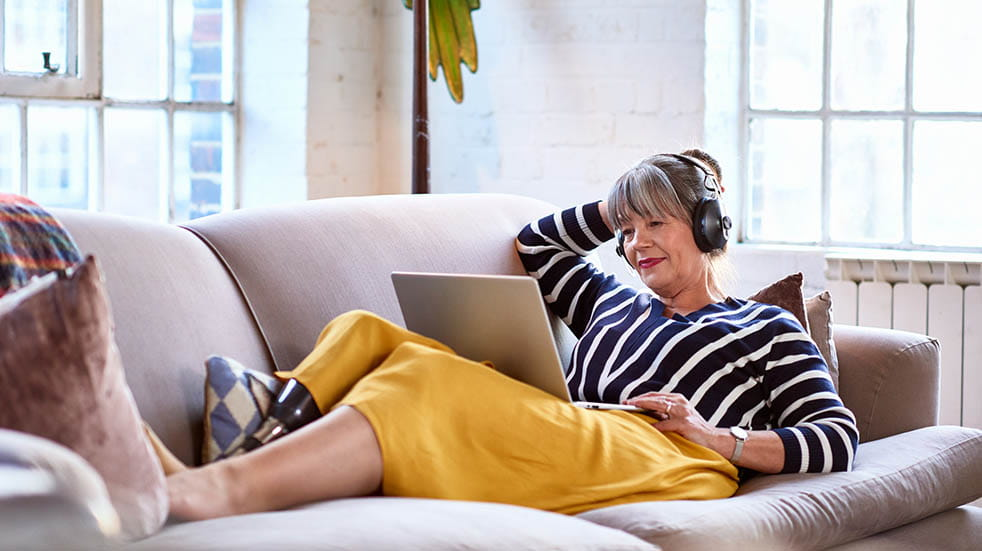 Best summer podcasts woman listening to headphones