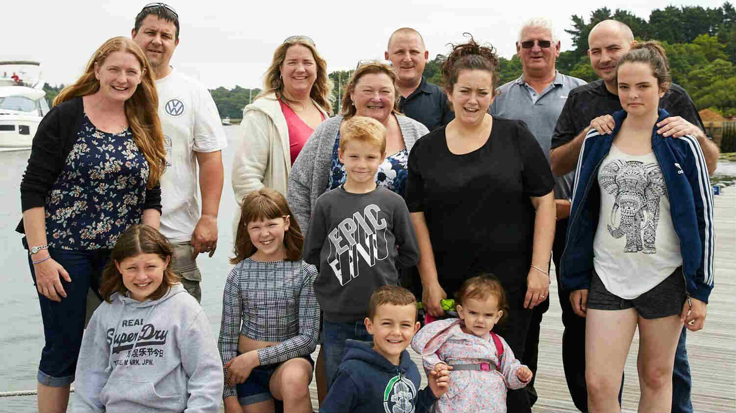 Boundless camping and caravan group: family at campsite