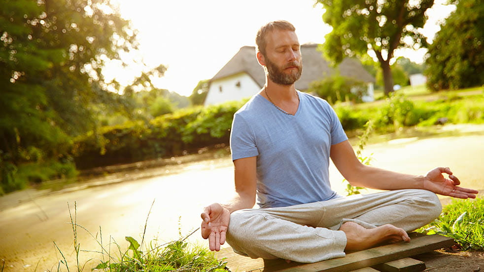 Breathing for mental and physical wellbeing; man meditating