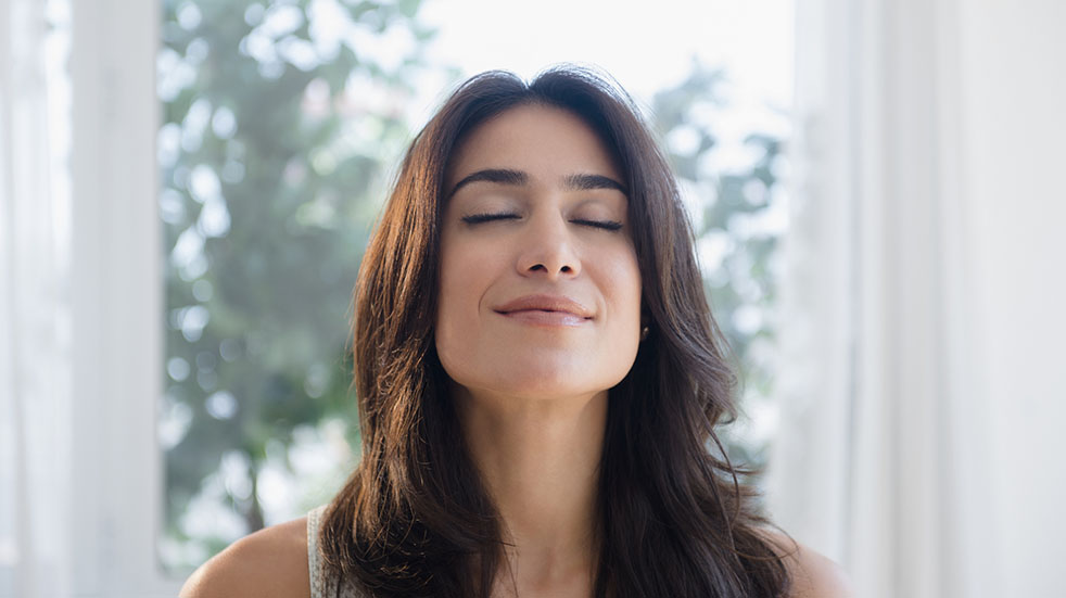 Breathing for mental and physical wellbeing; woman relaxing