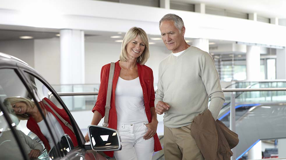 Buying a new car Griffin couple car showroom
