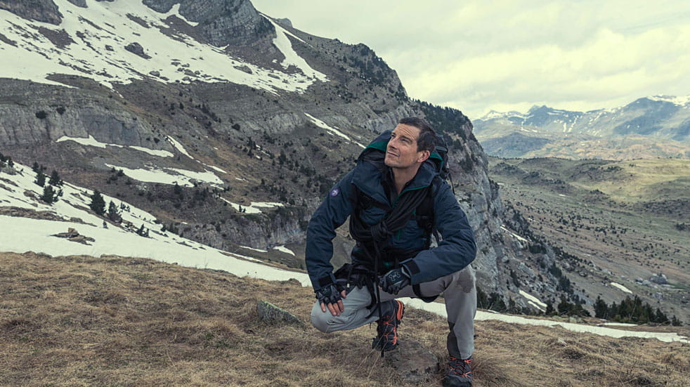 Bear Grylls climbs a mountain