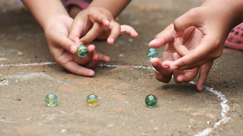Cheap ideas to entertain kids - play old school game of marbles