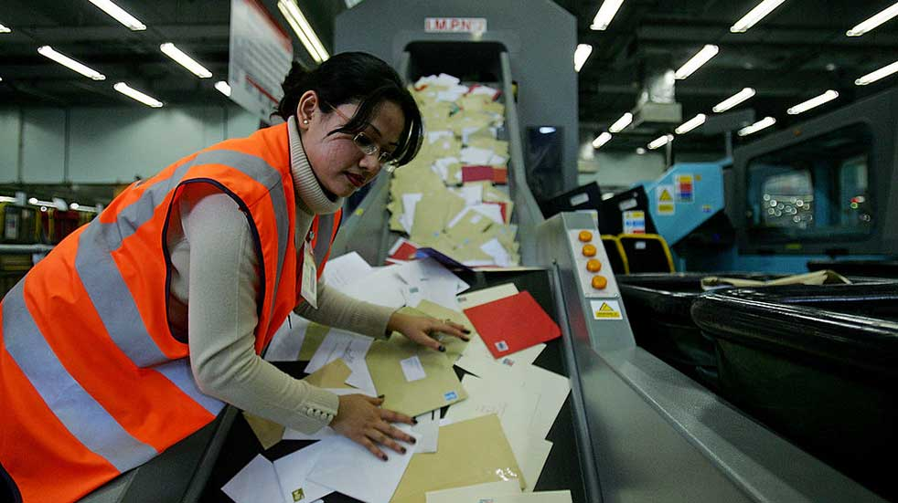 Christmas post woman sorting office