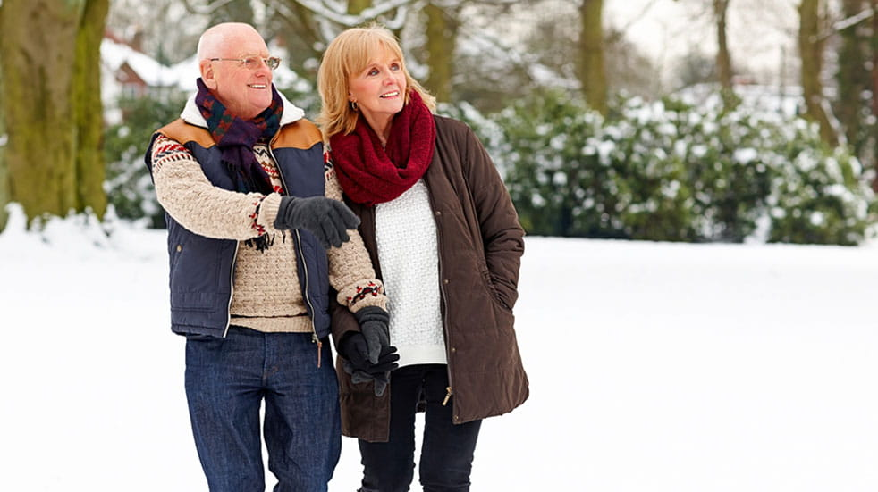 Claudia Hammond Christmas wellbeing tips man and woman walking snow