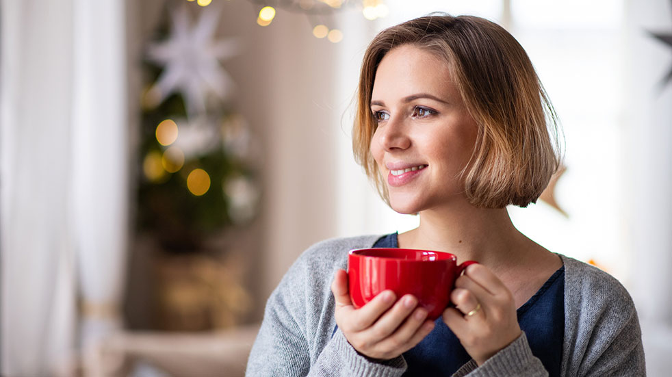 Claudia Hammond Christmas wellbeing tips woman smiling cup coffee