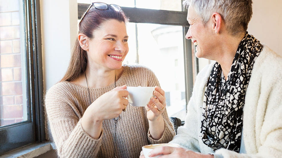 How to combat loneliness: two women talking with a cup of tea