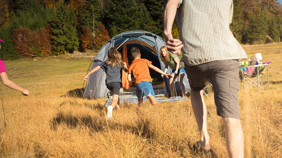 Cotswold Outdoor family camping in field