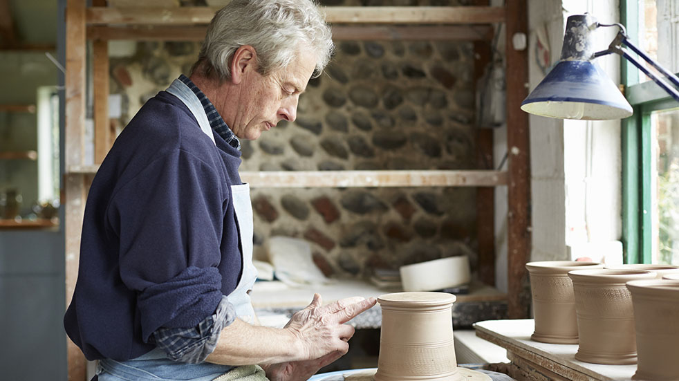 Crafting for mental health; man doing pottery