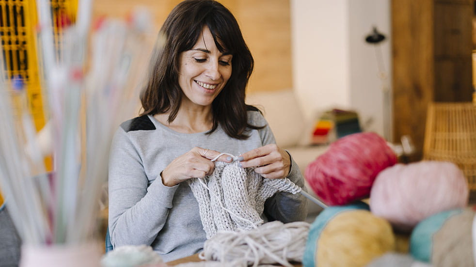 Crafting for mental health; woman knitting