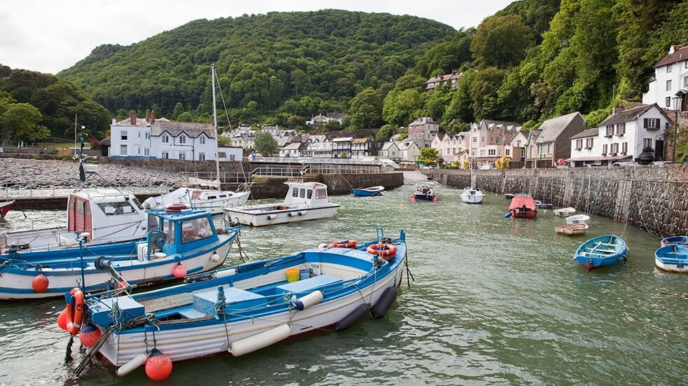 Boats in Lynmouth Harbour with the village in the background