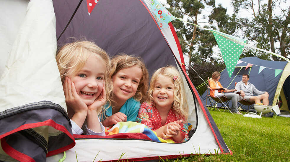 Luxury camping and glamping gear: family on campsite
