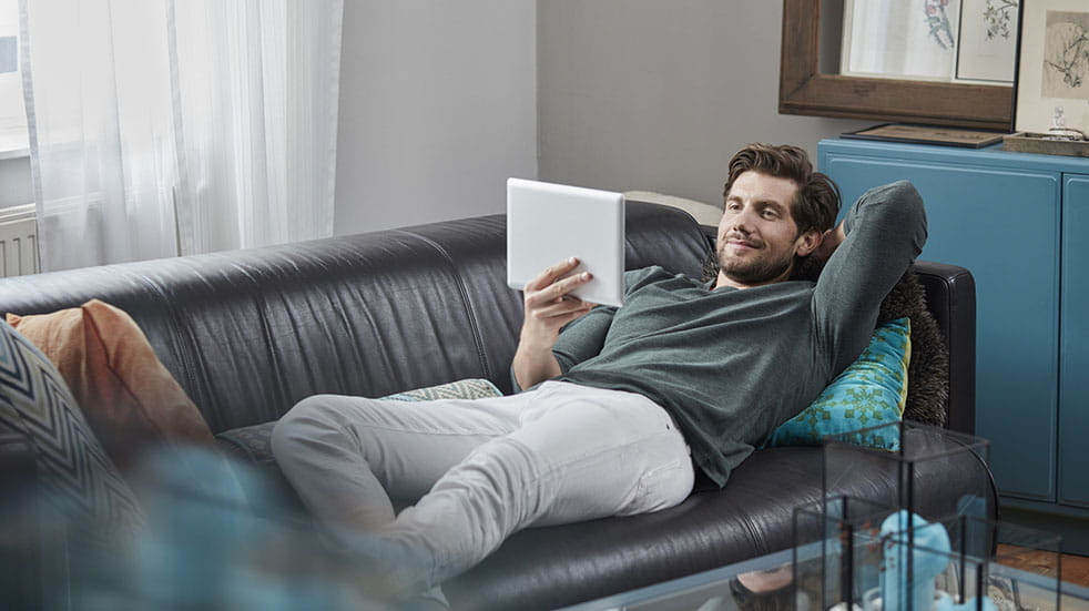 TV streaming; man with tablet