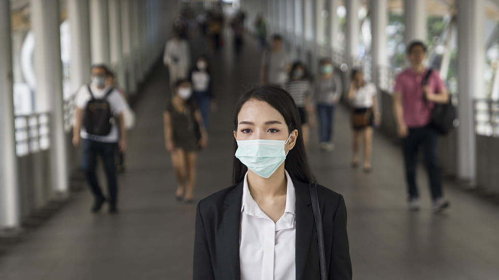 Everything you need to know about coronavirus; woman with a face mask