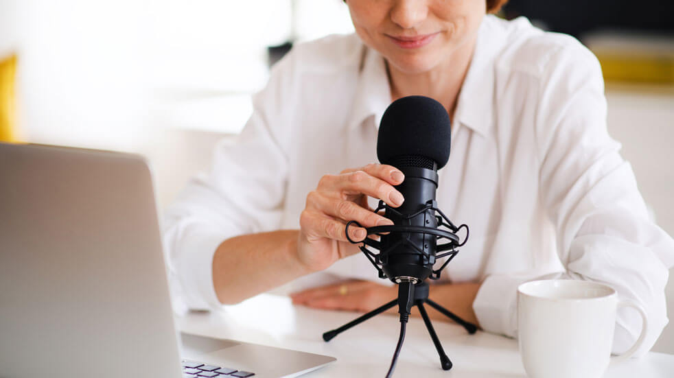Everything you need to know about podcasts; woman recording podcasts