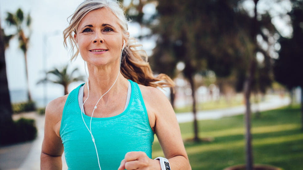Everything you need to know about podcasts; woman running with headphones on