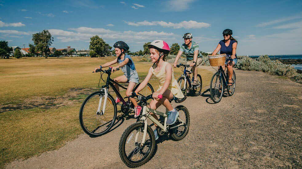 Get fit as a family - children and parents riding bikes