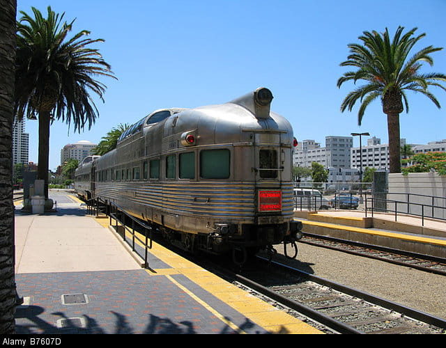 A silver Amtrak Zephyr train pulls into a station