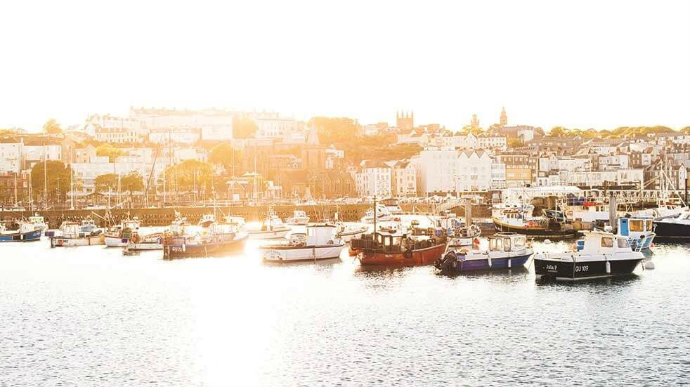 Boats in a Harbour with the sun rising behind