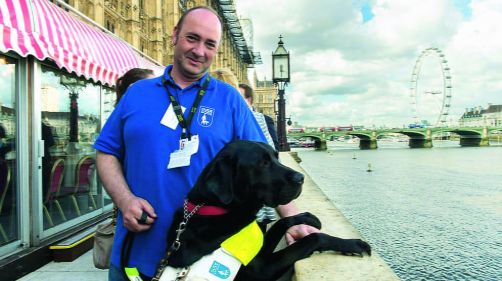 Pete Thomas with Guide Dog