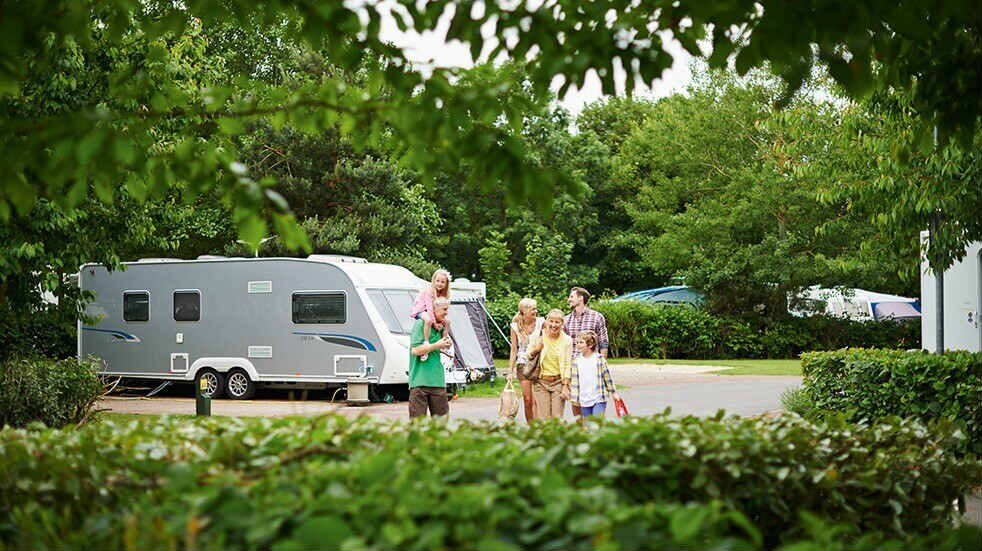 Haven holiday parks: family on walk around park