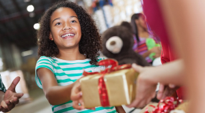 How to give to charity this Christmas girl smiling present